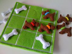 """Tic tac toe for dog lovers - the game """"board"""" is open at the top to store the pieces, with a dog house design on the back. It would be cute with black vs. white Scotty dogs too (instead of the bones)!"""