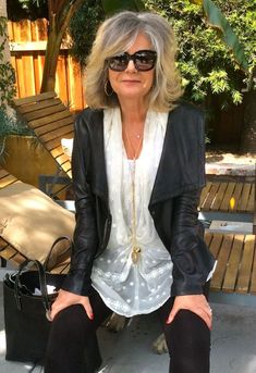 Gracefully growing out gray hair. I think she looks fabulous and love her unique sense of style! #ageless #beauty: