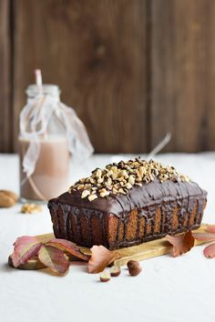 classic walnut cake with chocolate glaze and chopped nuts.