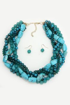 Love this chunky blue and teal statement necklace! Beautiful combination of colors and variations of stones and beads. Pretty!