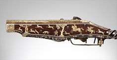 One of the earliest pistols, this firearm was designed and produced by Peter Peck, a maker of watches and guns. The two locks combined in one mechanism provided the barrels with separate ignition. Made for Emperor Charles V (reigned 1519–56), the pistol is decorated with his dynastic and personal emblems: the double-headed eagle and the pillars of Hercules with the Latin motto PLUS ULTRA (More beyond).