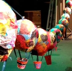 Papier mache balloons first, then cover with tissue paper. - kinder earth day project