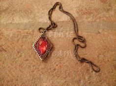 Dark gothic necklace with a red stone