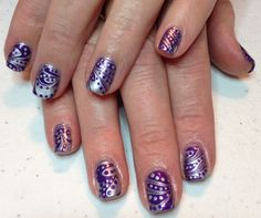 Purple paint, silver and clear water marble with dots of the same paint.