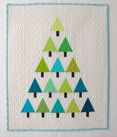 Modern christmas tree wall hanging- great idea if you have a vintage quilt!