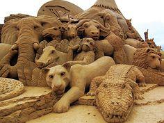 African animals: lions, elephants, warthog, crocodile, ape, monkey, etc ... Sand art sculpture