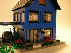blue lego house with car port, i LOVE the back door and the outside light (back view)