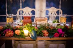 Gold, birch and burlap banded vases combine with garlands of fresh greens and pops of vivid color for Amy and Saad's bridal table at their Anthony Wayne House wedding - by Buttercup: Femina Photo and Design.