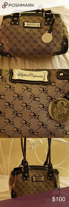Sophia Caperelli  purse The first opening in the front and back have magnet fasteners and middle compartment has a zipper. The bag is covered with initials SC. Silver embellishments. Also has a zipper pocket on the back. Excellent condition!! I really don't remember using it.. I'm addicted to hand bags.. lol Sophia Caperelli Bags Satchels