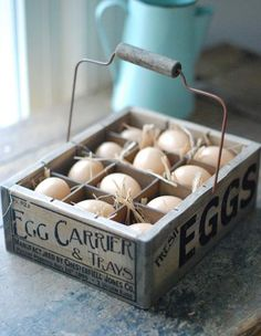 the wooden egg crate features a vintage style company logo, wire handle, and one dozen plastic eggs nestled in straw Primitive Bathrooms, Primitive Kitchen, Primitive Decor, Country Primitive, Vintage Farmhouse, Farmhouse Decor, Farmhouse Style, Egg Storage, Record Storage