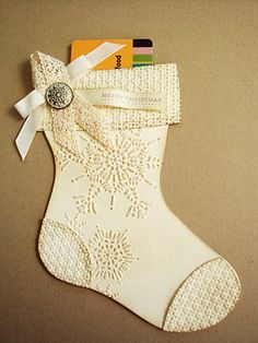 """penguinstamper: Holiday Stocking Die Gift-Card Holder Recipe: Paper: Very Vanilla - 8-1/2 X 5-1/2 (you'll need two of these for the front and back of the stocking); Very Vanilla - 3-1/2 X 1/2"""" Stamps: Teeny Tiny Wishes Inks: Crumb Cake (brayer the front side of your embossing folder to make the embossing stand out in white); Soft Suede Miscellaneous: Big Shot Machine; Holiday Stocking Die;"""