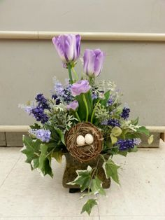 Lavender tulips with eggs.  Designed by Stephanie Alva