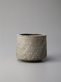 View Cylindrical pot (Circa By Lucie Rie; Stoneware, pitted off-white glaze over a finely fluted body. Access more artwork lots and estimated & realized auction prices on MutualArt. Ceramic Pots, Ceramic Tableware, Ceramic Clay, Ceramic Pottery, Pottery Art, Slab Pottery, Pottery Studio, Japanese Ceramics, Japanese Pottery