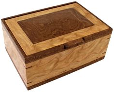 """Perfect for the Man who has everything this Men's Valet box features six 3"""" x 3"""" compartments for watches and two removable sliding trays for additional keepsakes.  The box is constructed of solid figured Cherry hardwood, trimmed with sepele accents and a solid sculpted sepele top.  The box features splined miter joints for enhanced stability and luxurious felt lining in all compartments."""
