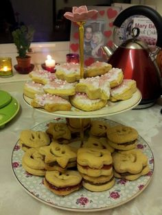 Smiley face jam and chocolate biscuits and iced shapes biscuits on lovely cake stand from Next