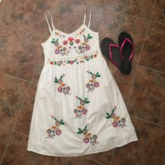 "ADORABLE Boho Dress White with colorful embroidered flowers. Worn once. 100% cotton. Upper side zipper for ease of putting on. Built in slip and thick enough at the bust you wouldn't have to wear a bra. See last pic for detail.  Perfect for spring. 17"" bust and 31"" length. Dress is sized Large but fits like a medium. Dresses Mini"