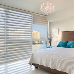 White, when used as a background, makes everything else in this bedroom stand out. Pirouette® window shadings ♦ Hunter Douglas window treatments