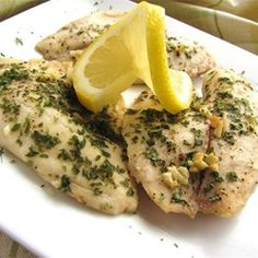 Lemon Garlic Tilapia | Tilapia fillets are bathed in lemon juice and melted butter, seasoned with garlic and parsley, and baked to flaky perfection.