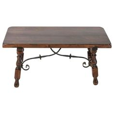 Spanish Renaissance Style Coffee Table or Bench with Hand Forged Iron Stretcher | From a unique collection of antique and modern coffee and cocktail tables at https://www.1stdibs.com/furniture/tables/coffee-tables-cocktail-tables/