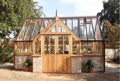 Beautiful example of a greenhouse with brick.
