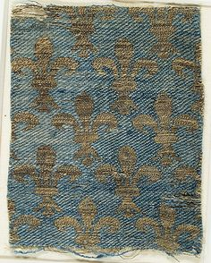 Textile with Brocade  Date:     13th–14th century Culture:     French or Italian Medium:     Silk, metal thread Dimensions:     Overall: 4 13/16 × 3 1/2 in. (12.3 × 8.9 cm) Storage (Mat with 46.156.54): 8 1/2 × 13 in. (21.6 × 33 cm) Classification:     Textiles Credit Line:     Rogers Fund, 1909 Accession Number:     09.50.1022
