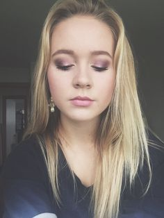 Purple eye makeup with pink lipstick