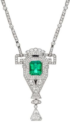 Edwardian Emerald & Diamond Pendant Necklace mounted in platinum.  The pendant is removable from the necklace chain so it can be worn separately as a brooch with detachable pin fittings.  Via 1stdibs.