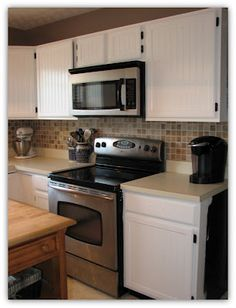 Updating kitchen cabinets with paint.