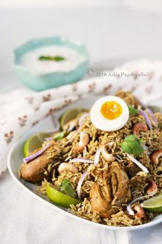 Chicken Biryani -- Biryani is typically a special occasion dish, for many reasons. This dish is particularly known for its many layers of flavors that slowly develop and meld together. So, it's a multi step process that requires much love in many installments over a long cooking time.