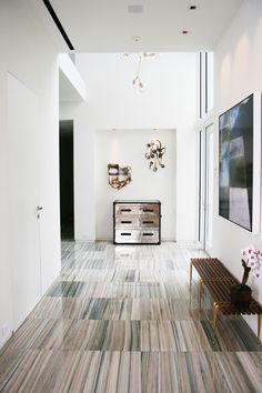 Marble floor but like the wood plank stripe effect