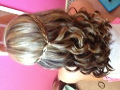 Half up half down hair curled with braid