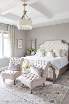 A gorgeous master bedroom space. The chairs and headboard are absolutely beautiful and have such an elegant look to them. The other decorative accents are a perfect compliment.