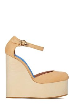 Jeffrey Campbell Dayle Platform - Wood  I'm usually anti-wedge but c'mon.  Jeffrey Campbell, duh.