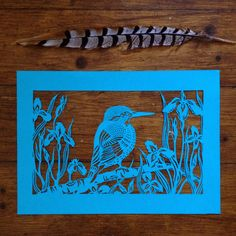 Bird paper cut. Kingfisher in Flag Iris, 2016. Handmade papercut by Stories In Paper (Ellie Chaney). www.storiesinpaper.com