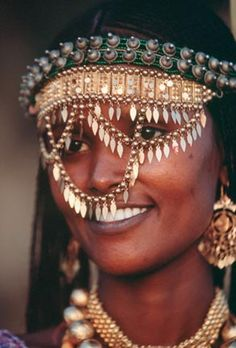 Ancient Egyptian People -- Africa | 'A Valuable Veil'.  For an Afar woman, putting on her jewelry is like wearing her bank account. In a strictly male-dominated culture, it is one of the few things a woman owns. Danakil Desert.  | © Carsten Peter
