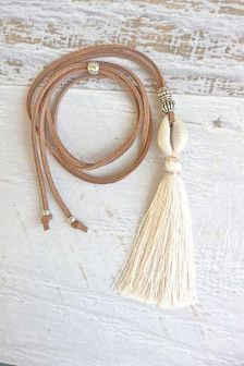 tassel necklace , cowrie shell necklace , bohemian jewelry. bohemian necklace  a new version of the long tassel necklaces i make. dark brown faux suede with a beautiful cowrie shell and 3 cream / white silk tassel and silver tibetan style beads. adjustable length with a sliding bead so it can be worn very long or shorter.  delivered in a white organza bag