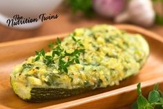 Spinach Stuffed Zucchini Boats | Scrumptious way to get veggies plus savory pine nuts | ONLY 77 Calories| Enjoy! :) For MORE RECIPES please SIGN UP for our FREE NEWSLETTER www.NutritionTwins.com