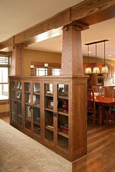 Bookcase built in with craftsman pillars to keep it open to the next room!