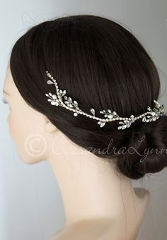 This bridal headpiece is simple but elegant! It features sprays of freshwater pearls and marquise rhinestones on a flexible rhinestone band in gold. It is 16 inches long and about 1 inch wide with a b