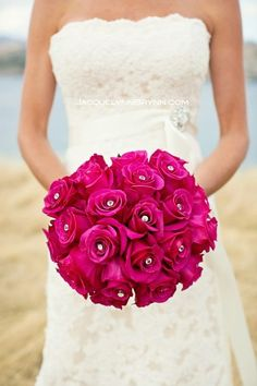 Bold, bright pink roses are classically arranged, with the jewel in the center of each bloom adding a special touch. Adding accents is a great way to personalize and make your bouquet uniquely you. Shop roses in a variety of eye-catching colors year-round at GrowersBox.com!