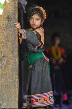 Everything about this picture of a little girl in Pakistan; love the costume.