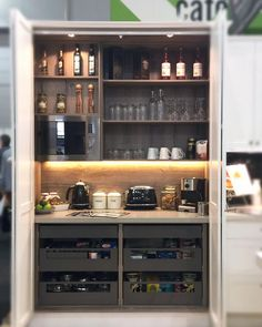 like this idea, clever kitchen storage behind cupboard doors by @designerkitchensbrisbane at the Brisbane Home Show, gave us some good ideas for our reno. #kitchen #theorganisedhousewife