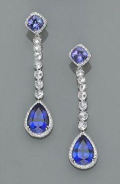 A pair of tanzanite, diamond and eighteen karat white gold earrings