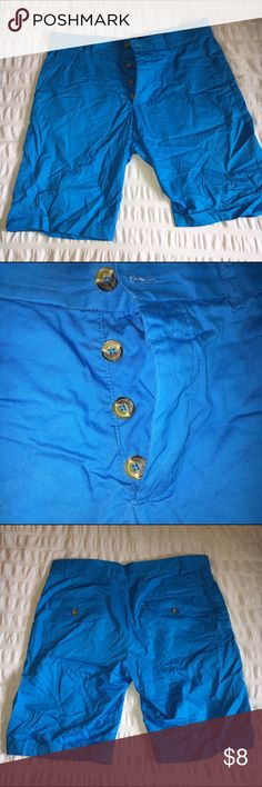 Blue Shorts Blue shorts with button fly. Will be laundered and steamed upon purchase to eliminate wrinkles. Excellent condition. Worn only twice. H&M Shorts Flat Front