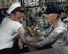 A sailor gets a tattoo on his arm in Virginia. PHOTOGRAPH BY PAUL L. PRYOR