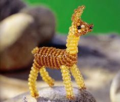 Toy Lama made of beads on a wire