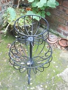 A 2 tier, coated iron, circular planter Listing in the Pots, Window Boxes & Baskets,Garden, Yard & Plants,Home & Garden Category on eBid United Kingdom