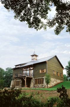 Relocated and renovated barn-home on the Cahaba River in Alabama. Dungan Nequette Architects.