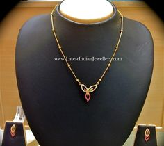 Ideal for work wear or simple occasions, this classy chain style gold necklace with three petal floral pendant studded with semi precious colored gemstones from nalli Gold Chain Design, Gold Jewellery Design, Necklace Designs, Gold Earrings Designs, Light Weight Gold Jewellery, Gold Mangalsutra Designs, Gold Necklace Simple, Gold Models, Gold Rings Jewelry
