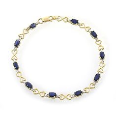 This fancy 10k yellow gold designer link bracelet features 10 oval shaped blue sapphires accented by 20 accent diamonds. The vibrant colored precious gemstones are genuine and natural. The blue sapphi...